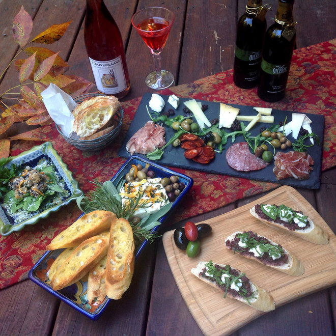 Dishes include (clockwise from bottom center) Marinated Feta with Olives; Fried Olives; Olive, Cured Meat and Cheese Platter; and Olive Tapenade, Arugula and Goat Cheese Spread.